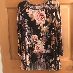 Black flower top with ruffle bottom. No tag